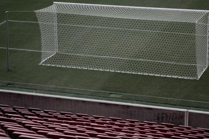 Soccer goal with empty seats behind it
