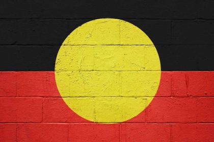 Aboriginal flag painted on brick wall