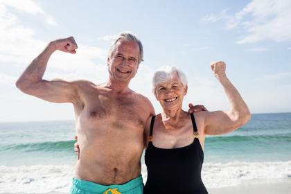 Flexing older couple on the beach